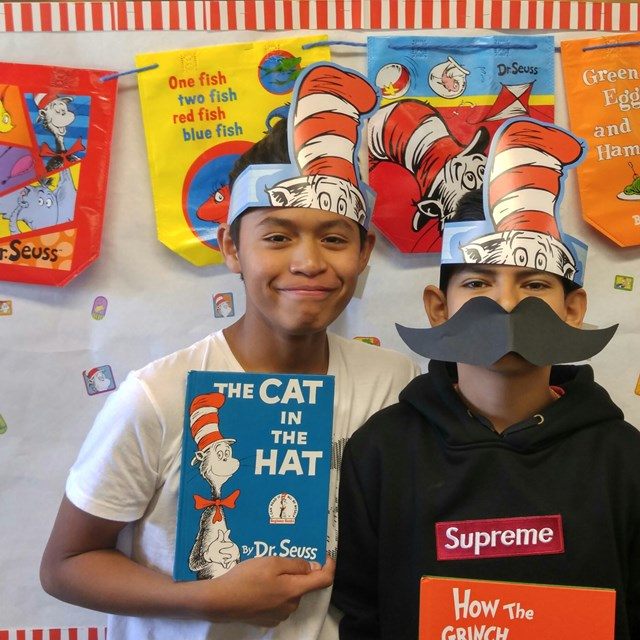 "Our two ""Cats in the Hat"" friends pose for a memorable snapshot."